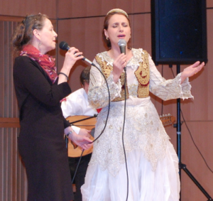 Prof. Jane Sugarman and Merita Halili sing an impromptu duet at a concert of Albanian music in the Live@365 world music concert series, February 2011.